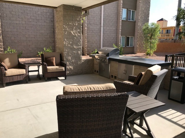 Covered patio and grill area
